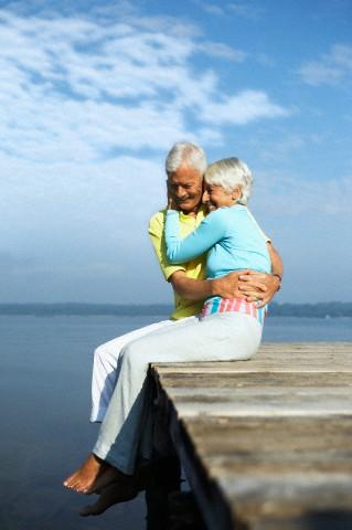Senior couple hugging on jetty